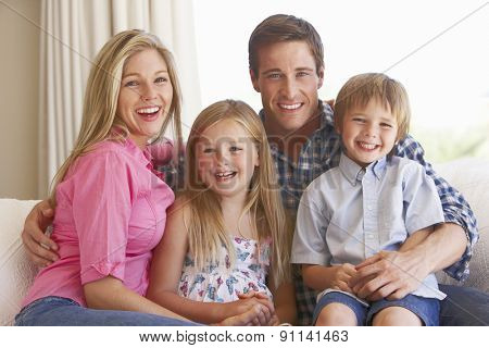 Family Relaxing On Sofa At Home