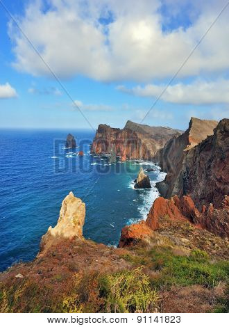 Easternmost tip of the island of Madeira. It is red and orange rocks coolly grow from foamy waves of the Atlantic Ocean