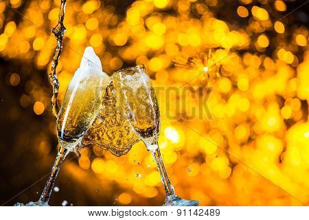 A Pair Of Champagne Flutes With Golden Bubbles Make Cheers On Golden Light Background With Space For