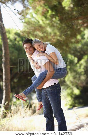 Young Couple Having Fun On Countryside Walk