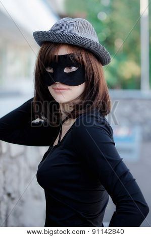 Beautiful Elegant Woman In A Hat And Carnival Mask