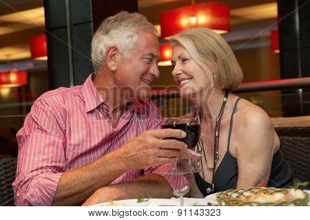 Senior Couple Enjoying Meal In Restaurant