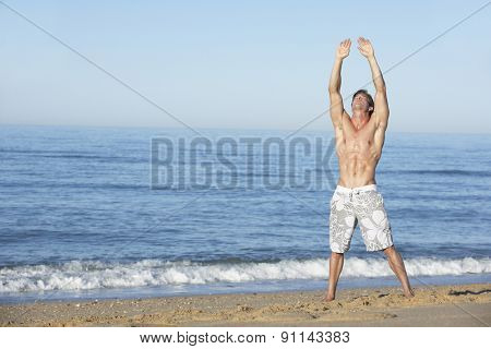 Young Man Standing On Summer Beach