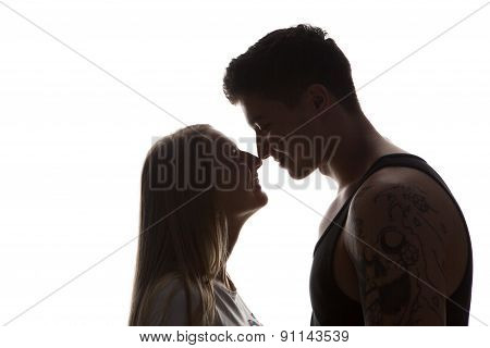 Silhouette Of Two Lovers. Isolated On White Background