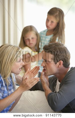 Parents Having Argument At Home In Front Of Children