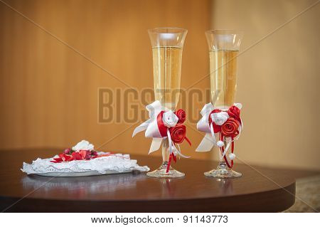 Two Glasses Of Champagne On The Table