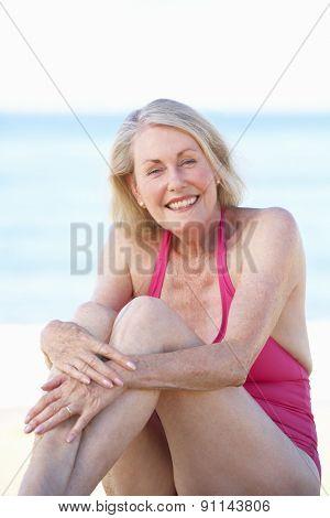 Senior Woman Sitting On Summer Beach