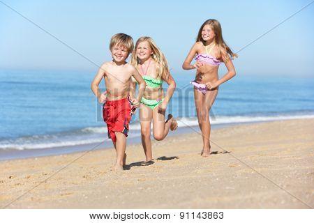 Children Running Along Summer Beach