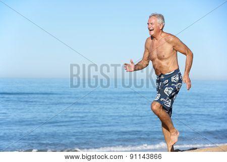 Senior Man Running Along Summer Beach