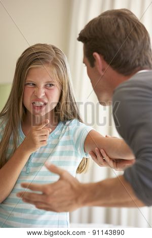 Father Telling Off Daughter At Home