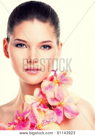 Portrait of beautiful young woman with healthy skin and pink flowers on body - isolated on white