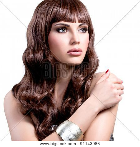 Portrait of a beautiful young woman with long brown hairs.