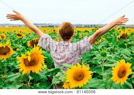 Woman in the sunflower field