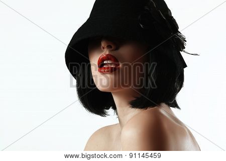 Woman In A Hat And A Wig