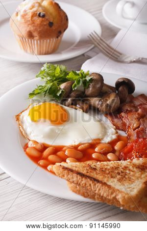 A Hearty English Breakfast Close-up On A Plate. Vertical