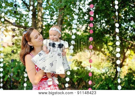 Beautiful Mother And Baby Playing In A Park. Outdoors. Nature.