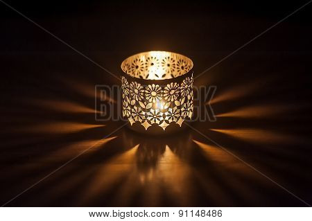 Lighted Candle In A Candlestick