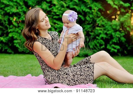 Beautiful Mother And Baby Playing In A Park. Outdoors. Nature. Beauty Mum And Her Child Playing Outd