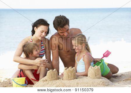 Portrait Of Family Enjoying Beach Holiday