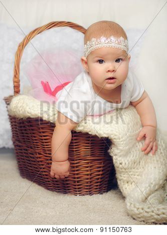 cute little girl try to get out of basket