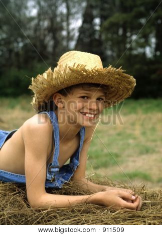 Boy On Hay Bale  Smiling