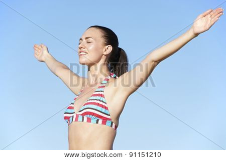 Young Woman Standing On Summer Beach