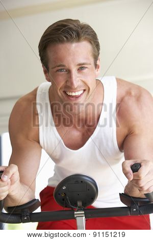 Young Man On Exercise Bike