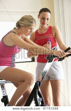 Young Woman On Exercise Bike With Trainer