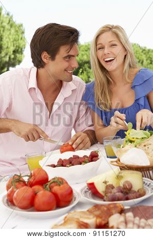 Young Couple Enjoying Outdoor Meal Together