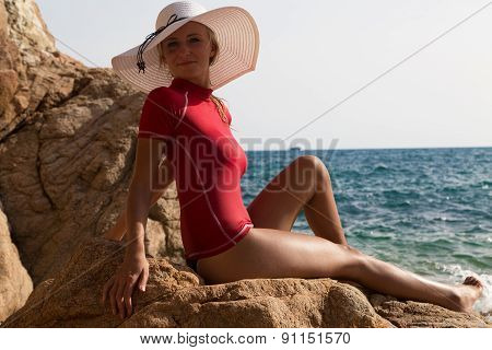 Sexy Girl In Sportwear And Tanga On The Rocky Beach