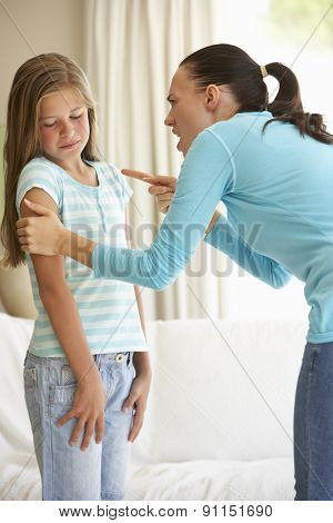 Mother Telling Off Daughter At Home