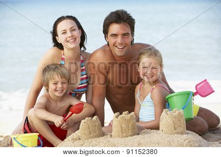 Portrait Of Family Enjoying Beach Holiday