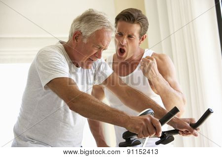 Senior Man On Exercise Bike With Trainer