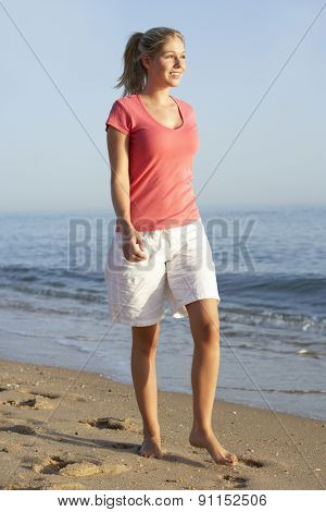 Woman Walking Along Beach