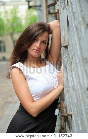 Beautiful young woman walking outdoors