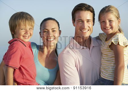 Portrait Of Young Family On Beach Holiday