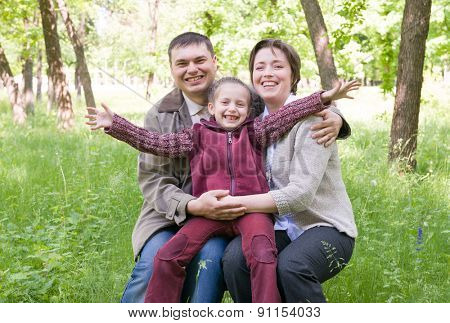 Family in the park at spring