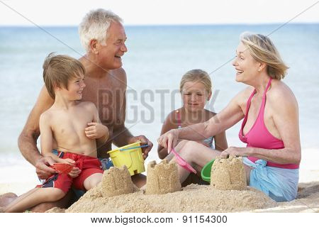Grandparents And Grandchildren Enjoying Beach Holiday