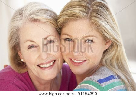 Senior Woman Relaxing At Home With Adult Daughter