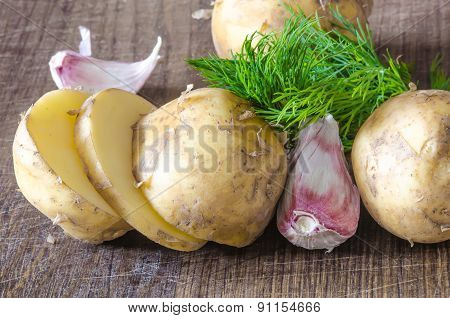 Organic vegetables with green-stuff on wooden table