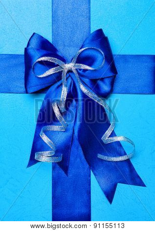 blue bow made from silk on cyan background