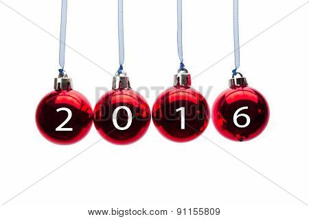Hanging red christmas balls on white background