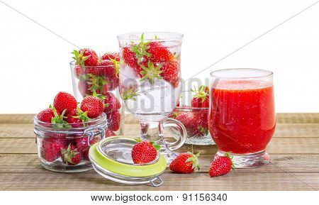 Strawberry smoothie with fresh berries isolated on white background.