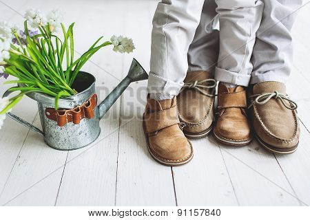 Legs Of Boy And Man, In Moccasins With Flowers