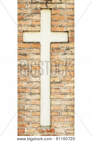 cross on the weathered red brick wall