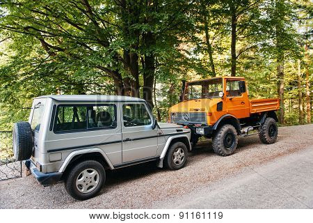 Unimog And Mercedes-benz G-class Gelandewagen In Front Of Each Other