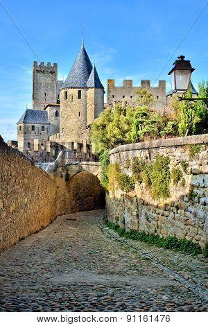 Cobblestone lane through the fortress of Carcassonne, France