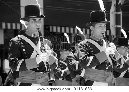 Young unidentified men in soldier costume parade