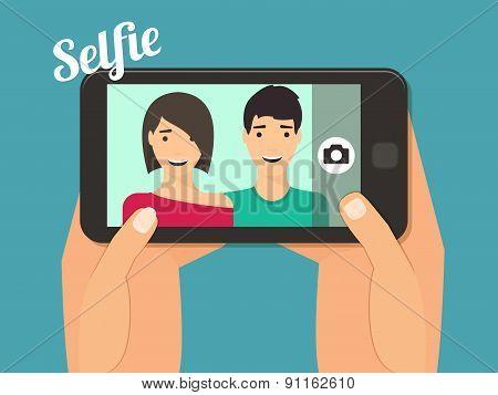Couple taking selfie.