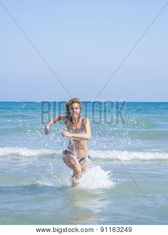 Woman on the beach in Kuta Bali Indonesia